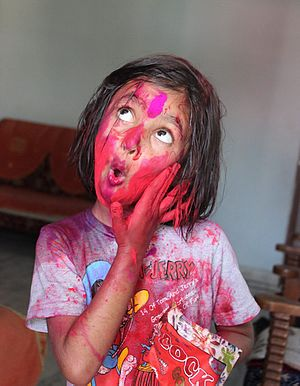 Littile_Girl_Playing_Holi_with_Gulaal